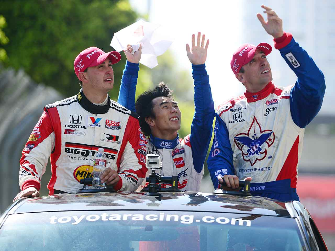 """Former teammate Graham Rahal (left with Takuma Sato, center) said of Wilson, """"A lot of drivers are great because they're selfish. But Justin was always the first guy to come up to me and say something positive, something constructive, something helpful. You mention 'team player,' that's Justin, and it's hard to find that sort of guy in sports. He was just the nicest guy out there."""""""