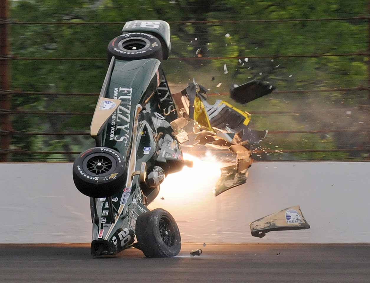 After the death of Dan Wheldon in 2012 (Ed Carpenter is pictured here), Wilson was selected along with Dario Franchitti and Tony Kanaan to represent the drivers in talks with IndyCar. Among his safety proposals: seamless metal barriers that allow cars to slide freely without getting snagged, and grandstands that are inside racing ovals to better protect fans because debris usually flies to the outside.