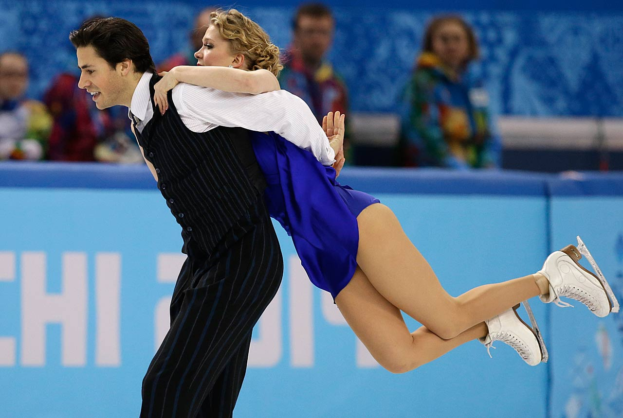 Kaitlyn Weaver and Andrew Poje of Canada compete in the short dance figure skating.