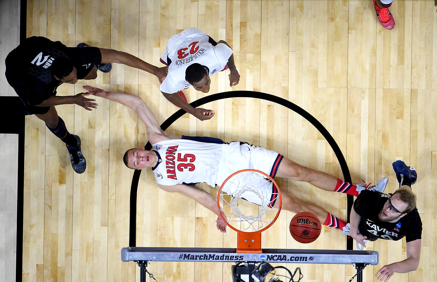 Kaleb Tarczewski of the Arizona Wildcats falls back on the court in a West Regional semifinal game against Xavier.