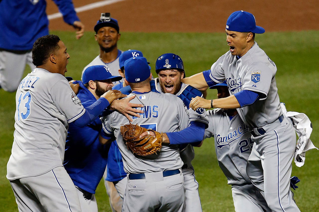 Wade Davis (No. 17) of the Kansas City Royals and Drew Butera (No. 9) celebrate with teammates after defeating the New York Mets 7-2 to win the World Series.