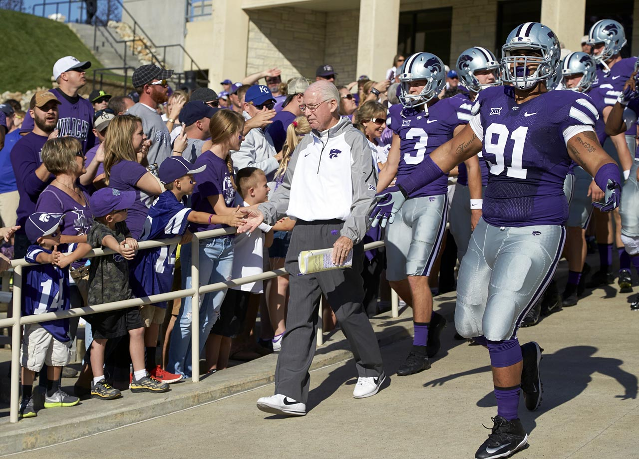 K-State is synonymous with two things: purple, and Bill Snyder. The purple adorns the uniforms, and Coach Snyder's name adorns the stadium, where he still stalks the sidelines on game day. Royal Purple, to be specific, has been a part of Kansas State tradition since 1896. It dominates every K-State uniform, and is the name of the school yearbook. Snyder has only been with the team since the 1989 season, but in Manhattan, Kansas, he's more ubiquitous than the team colors.