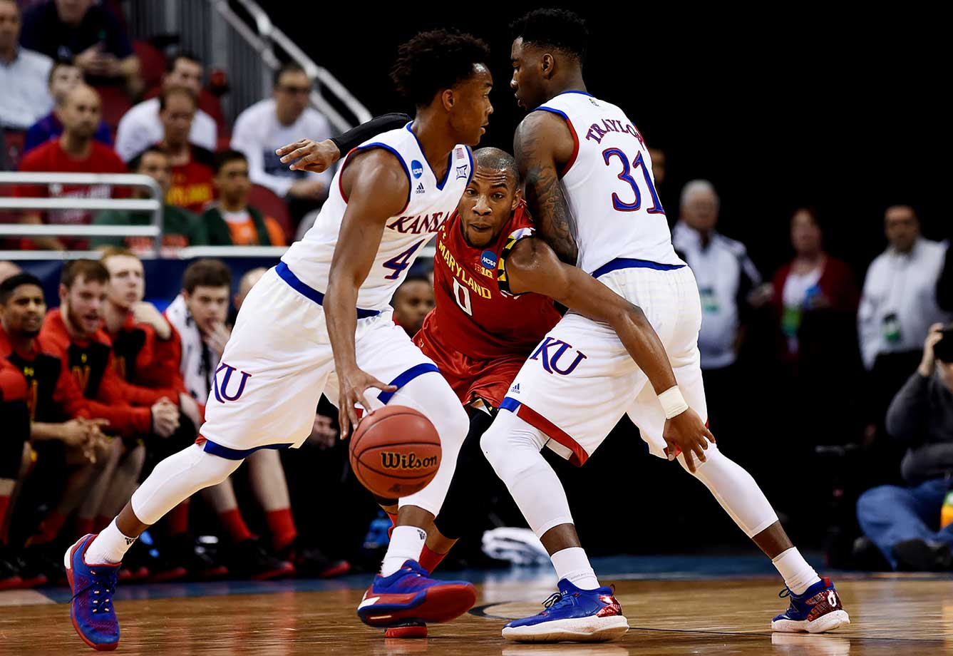 Rasheed Sulaimon of Maryland attempts to get by Jamari Traylor to get to Devonte' Graham.