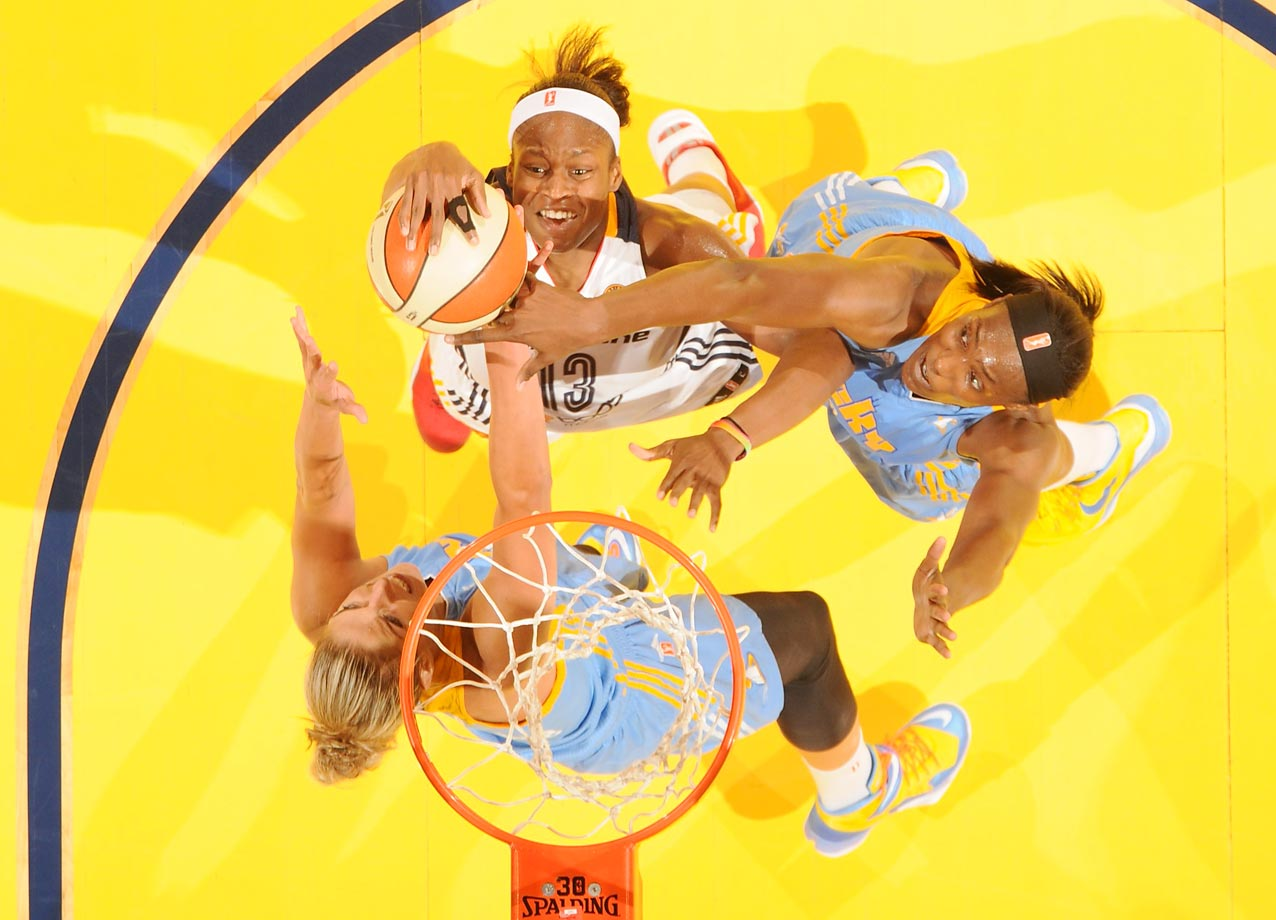 Karima Christmas of the Indiana Fever shoots against Elena Delle Donne of the Chicago Sky during Game 1 of the 2014 WNBA Eastern Conference Finals.