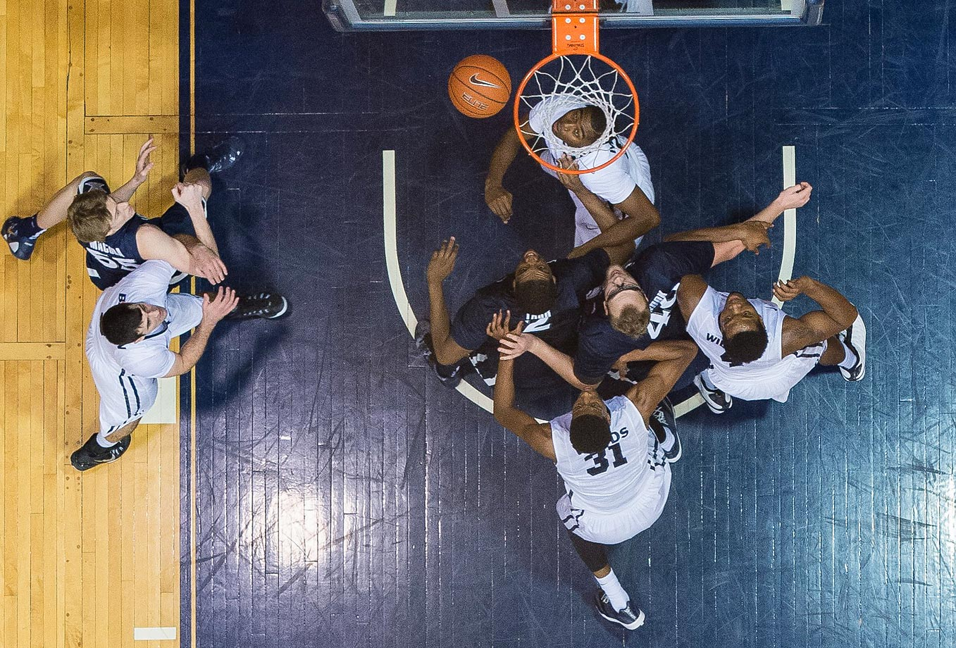 Butler Bulldogs forward Kelan Martin looks up through the net as Butler Bulldogs forwards Kameron Woods (31) and Tyler Wideman (4) battle Xavier Musketeers forward James Farr (2) and center Matt Stainbrook (40) battle for position.