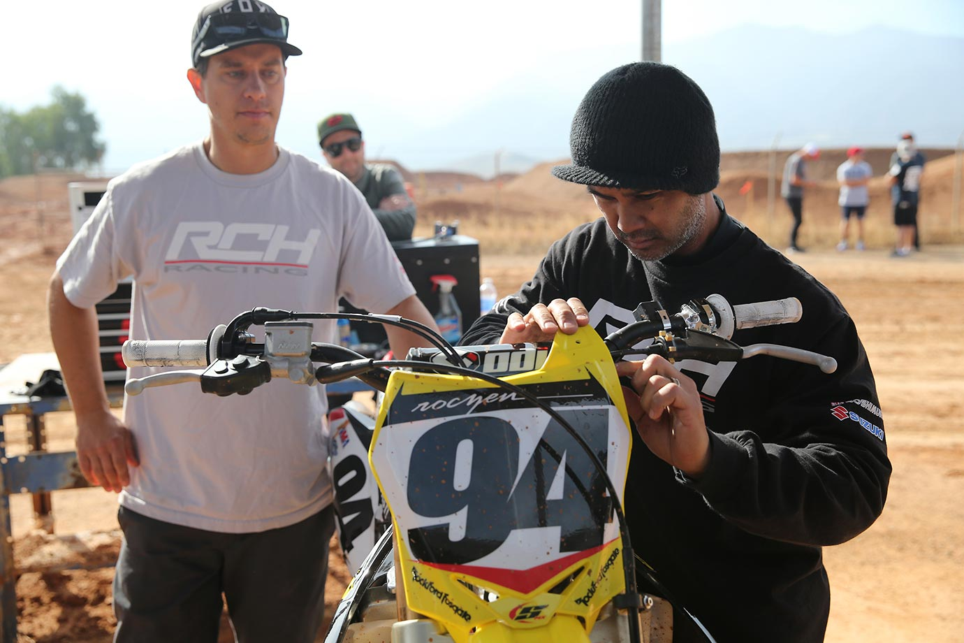 Ken Roczen's mechanics make some minor adjustments to his Suzuki bike during practice.