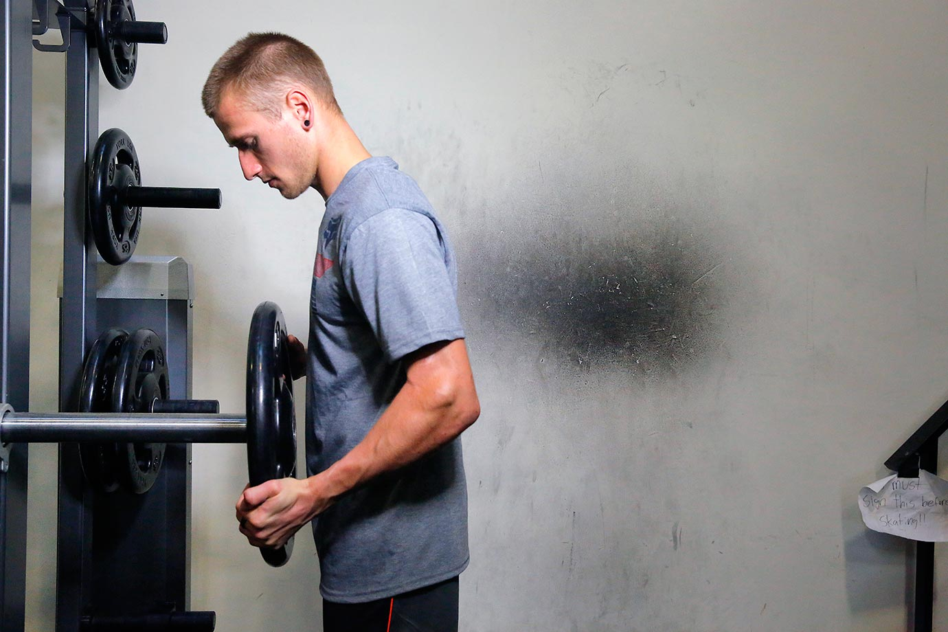 Ken Roczen puts some weights on the machine at the gym this week during training.