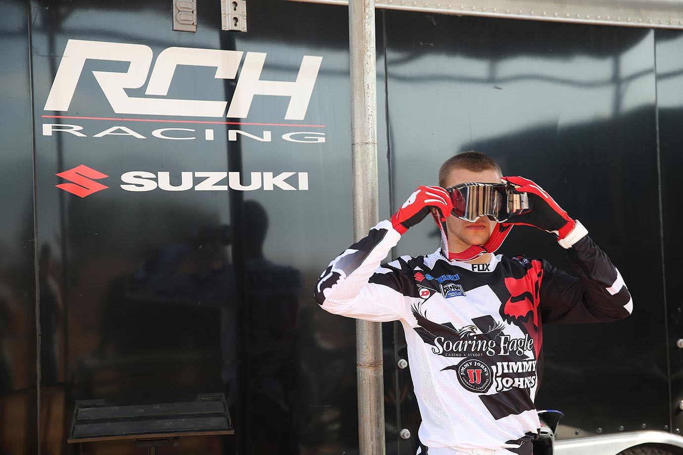 Ken Roczen, who races for the RCH Racing Suzuki team in Supercross, adjusts his goggles before taking to the dirt track for practice this week.
