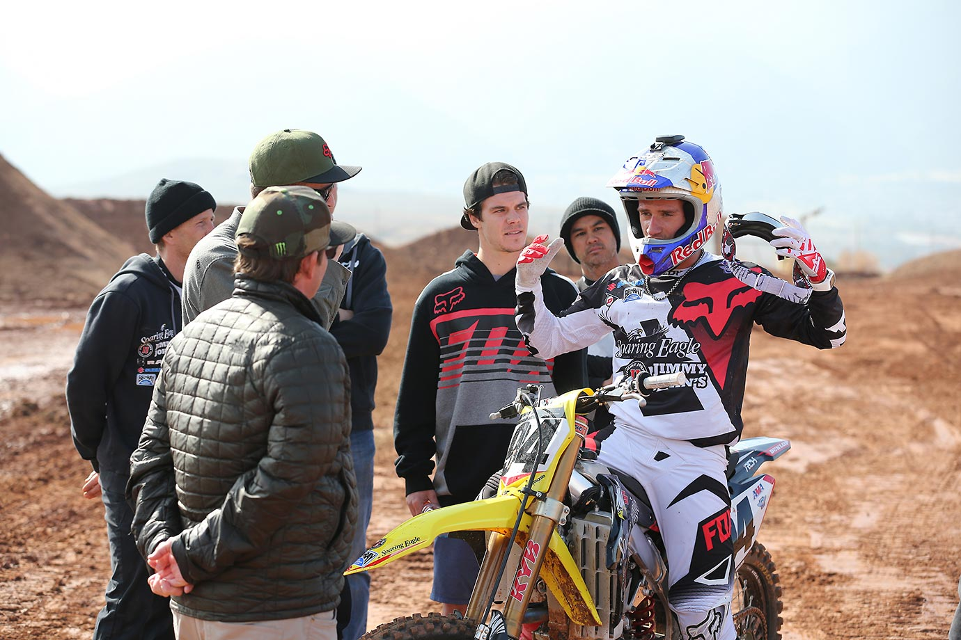 Ken Roczen talks strategy with his team.