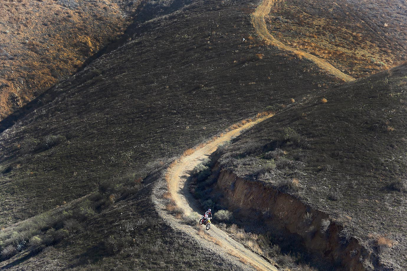 Ken Roczen rides down a mountain trail in the hills of Corona.