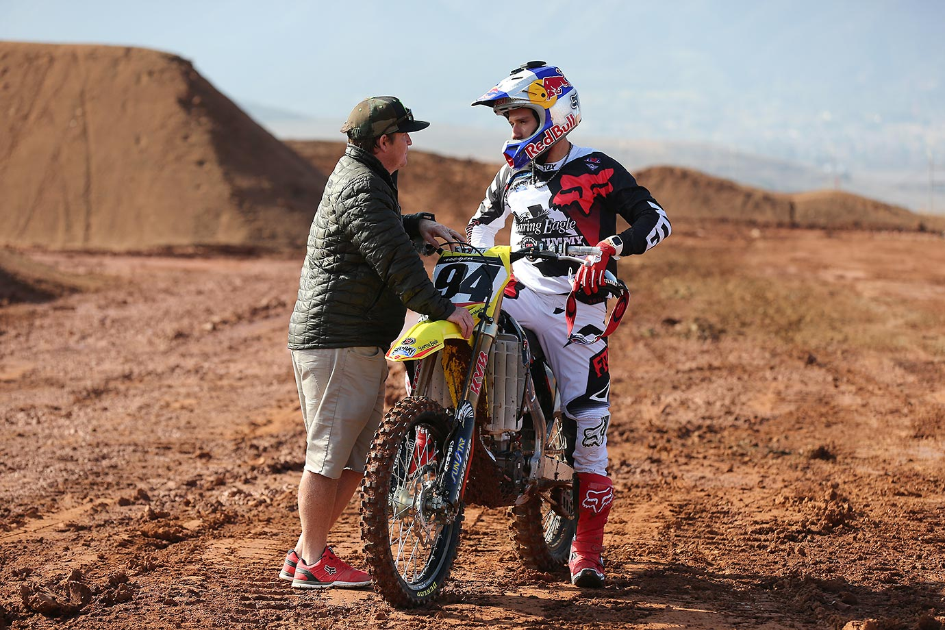 Ken Roczen, right, talks with Ricky Carmichael after a few practice runs on the track.  Roczen rides the  No. 94 Suzuki for RCH Racing, which is co-owned by Cary Hart and Ricky Carmichael.
