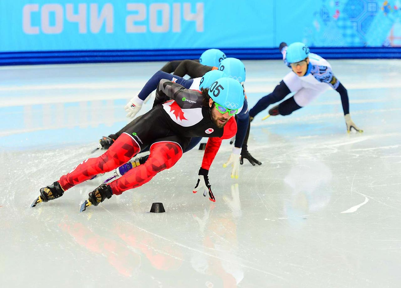 Canadian Charles Hamelin held off China's Han Tianyu and Russia's Viktor Ahn to win the men's 1,500-meter short track speedskating competition.