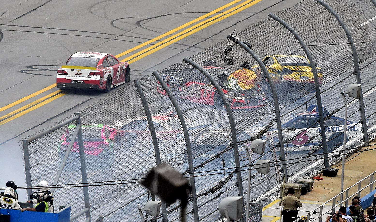 Kevin Harvick drives past a wreck at the NASCAR Sprint Cup Series auto race at Talladega Superspeedway.