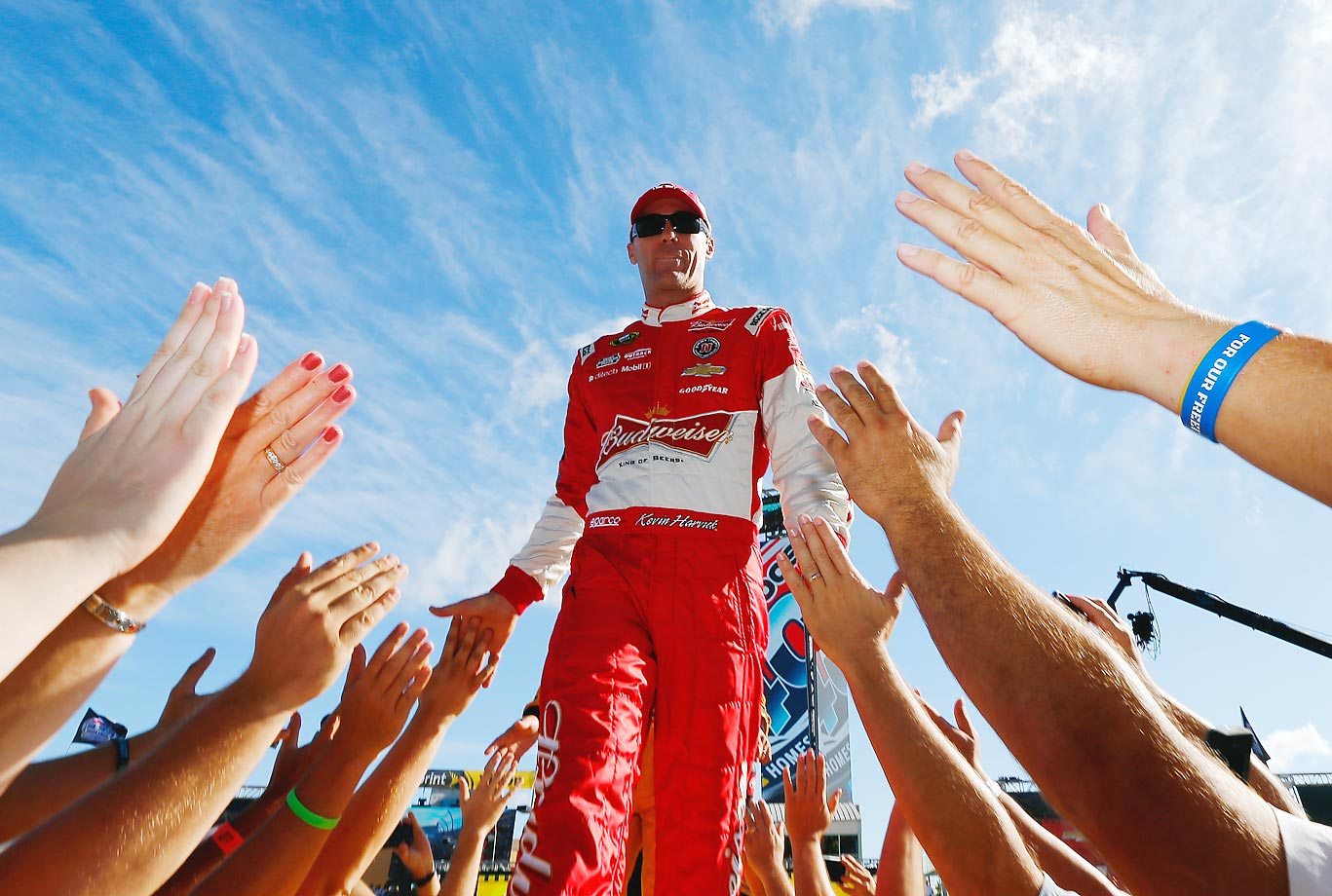 Kevin Harvick is introduced during pre-race ceremonies for the NASCAR Sprint Cup Series Ford EcoBoost 400 in Homestead, Fla.