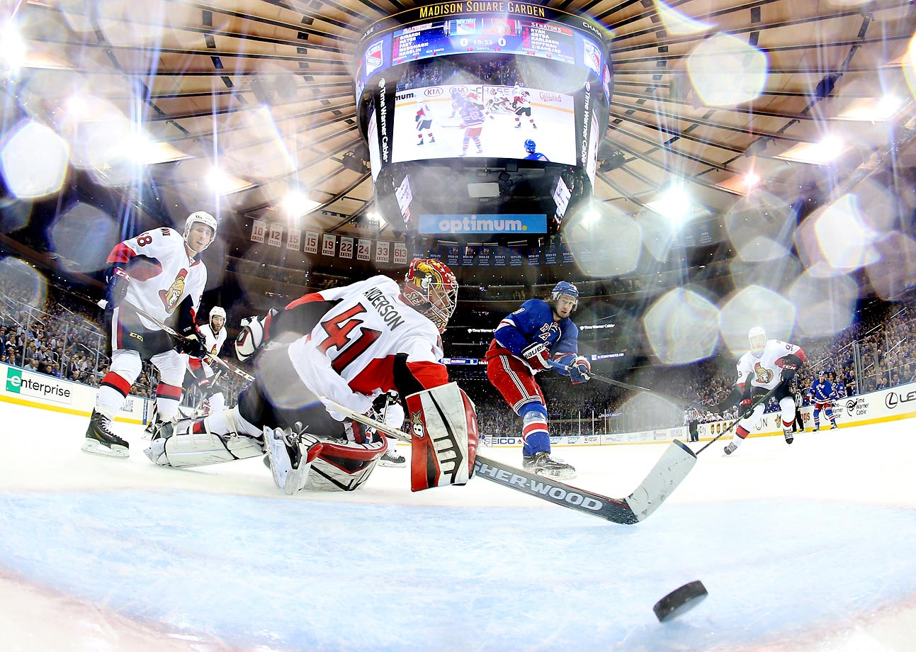 Kevin Hayes of the New York Rangers scores a goal in the second period against Craig Anderson of the Ottawa Senators.