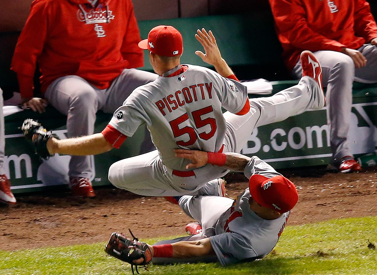 Stephen Piscotty of the Cardinals collides with Kolten Wong while going for a pop up in foul territory against the Cubs in Game 3. Piscotty manages to make the catch.