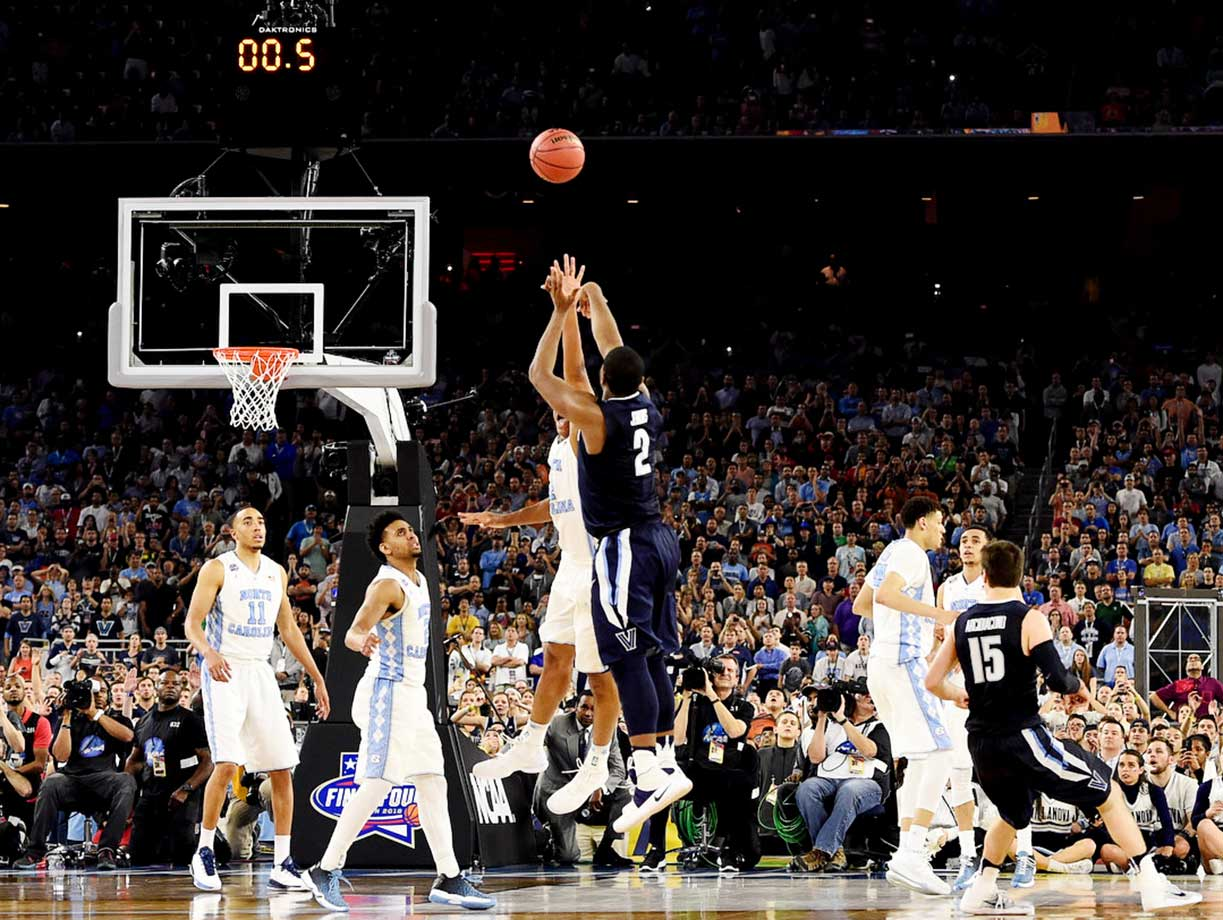Kris Jenkins shoots the game-winning three pointer to push Villanova past the North Carolina Tar Heels 77-74 in the national title game.