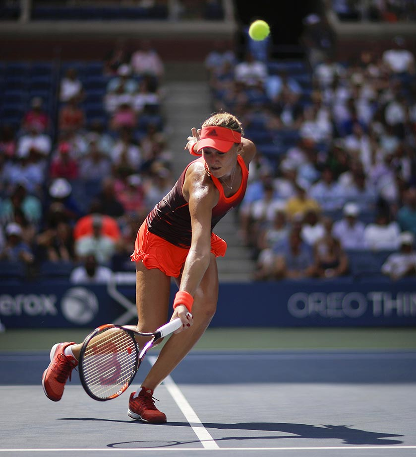 Kristina Mladenovic misses this return against Roberta Vinci in the quarterfinals of the U.S. Open.