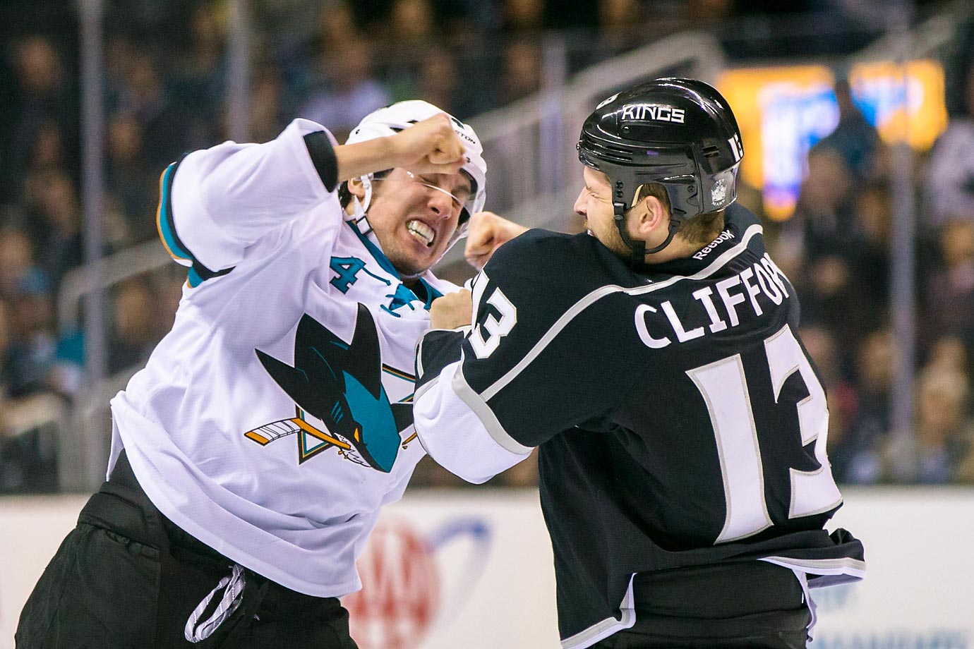 Los Angeles Kings left wing Kyle Clifford and San Jose Sharks defenseman Brenden Dillon fight in the first period.