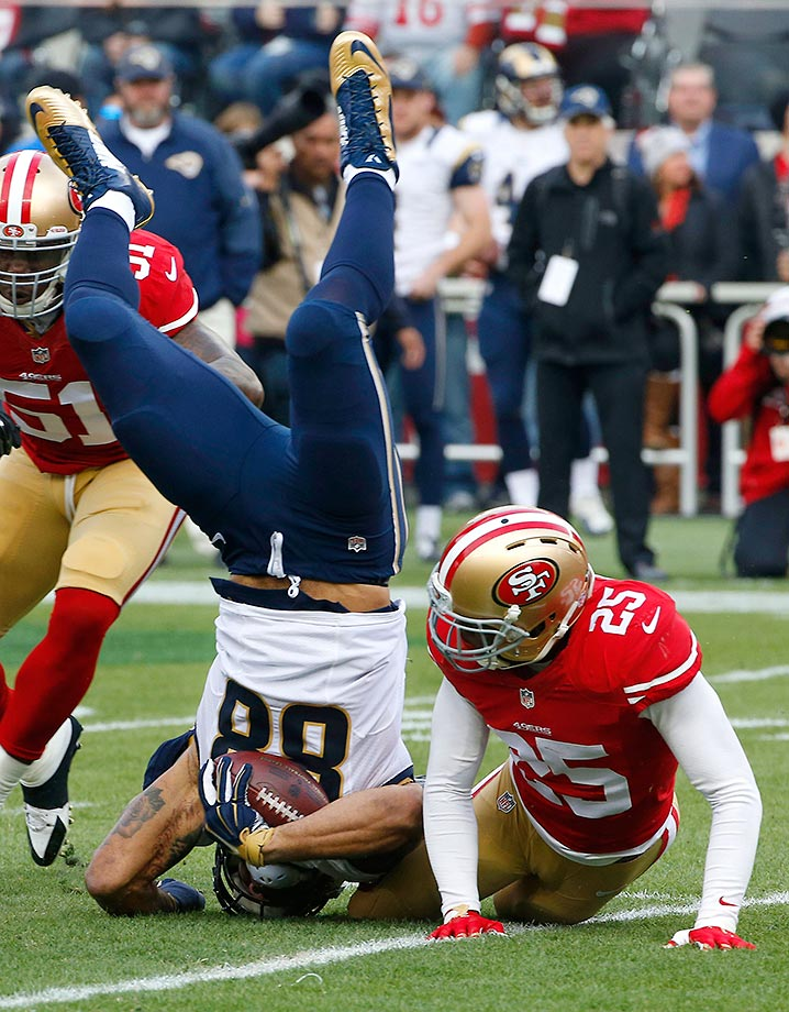 Lance Kendricks of the St. Louis Rams is tackled by Jimmie Ward of the San Francisco 49ers.