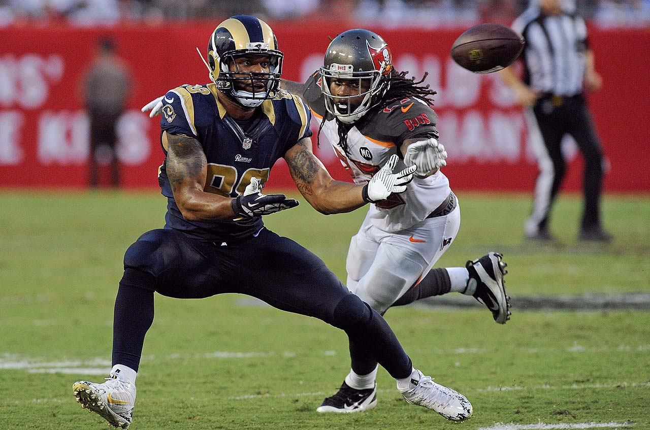 Lance Kendricks of the St. Louis Rams catches a pass in front of Mark Barron of the Tampa Bay Buccaneers.
