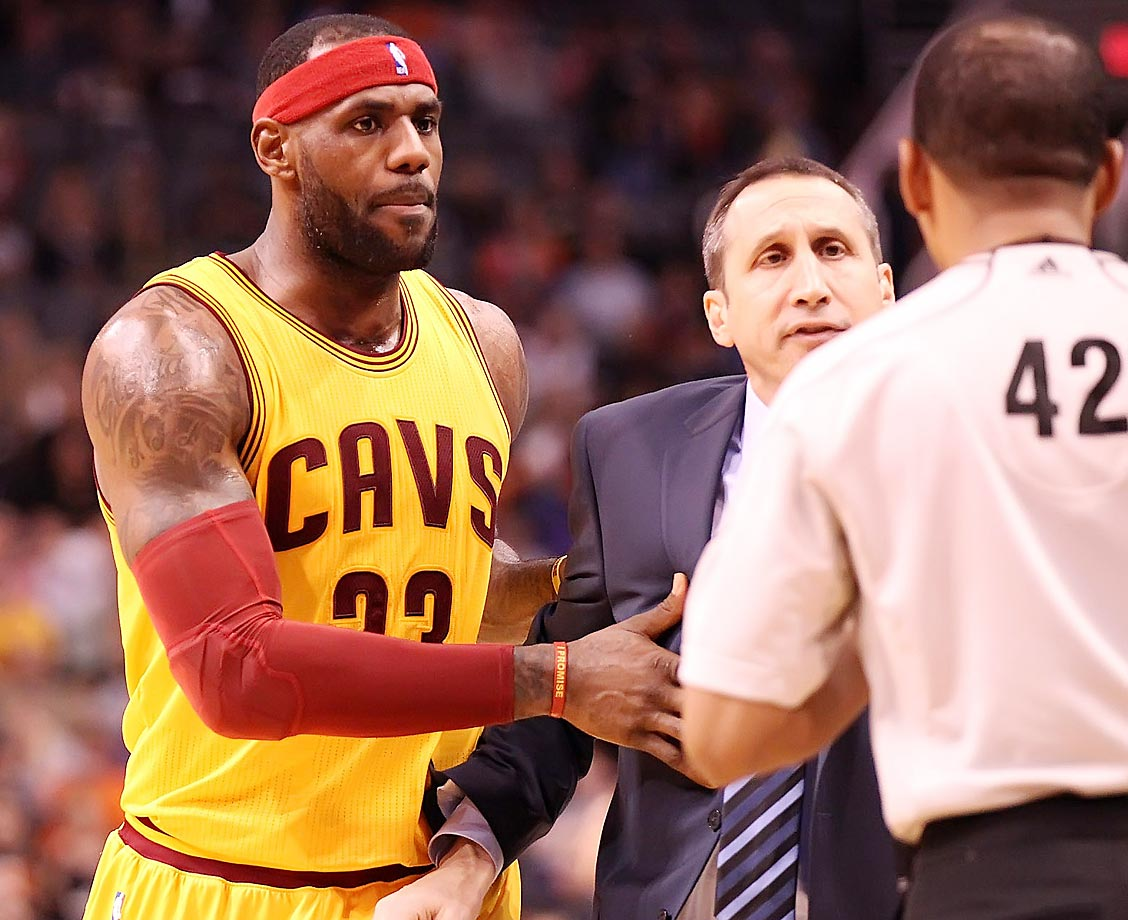 LeBron James moves Cleveland Cavaliers coach David Blatt out of the way during their loss to the Phoenix Suns.