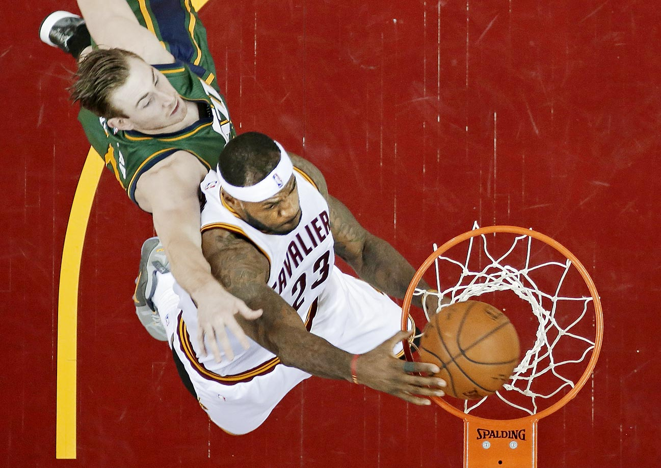 LeBron James dunks on Gordon Hayward of the Jazz. James scored 26 points to lead Cleveland to a 106-92 win.