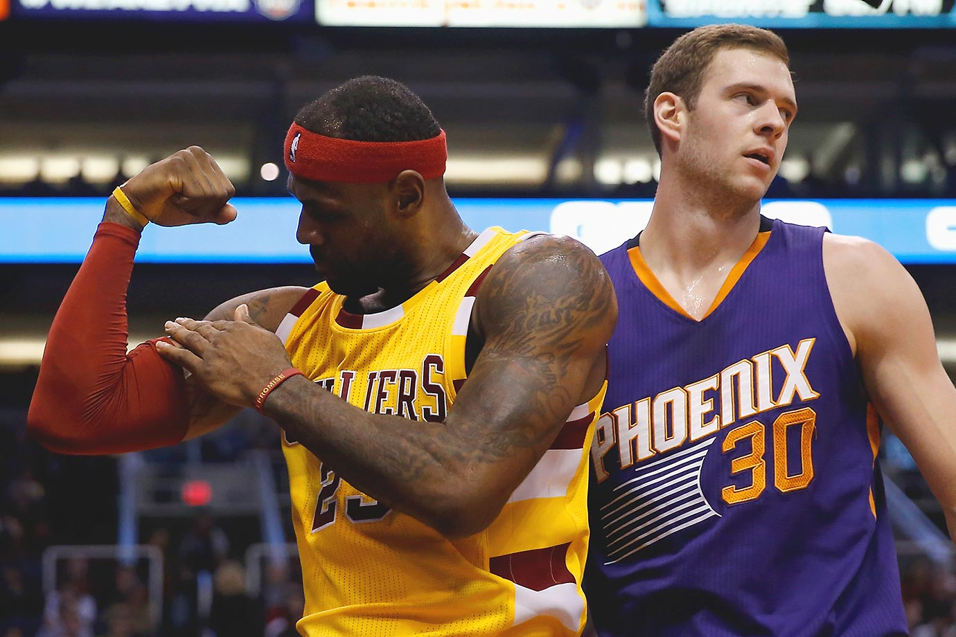 LeBron James of the Cleveland Cavaliers flexes after scoring and drawing a foul from Jon Leuer of the Suns.
