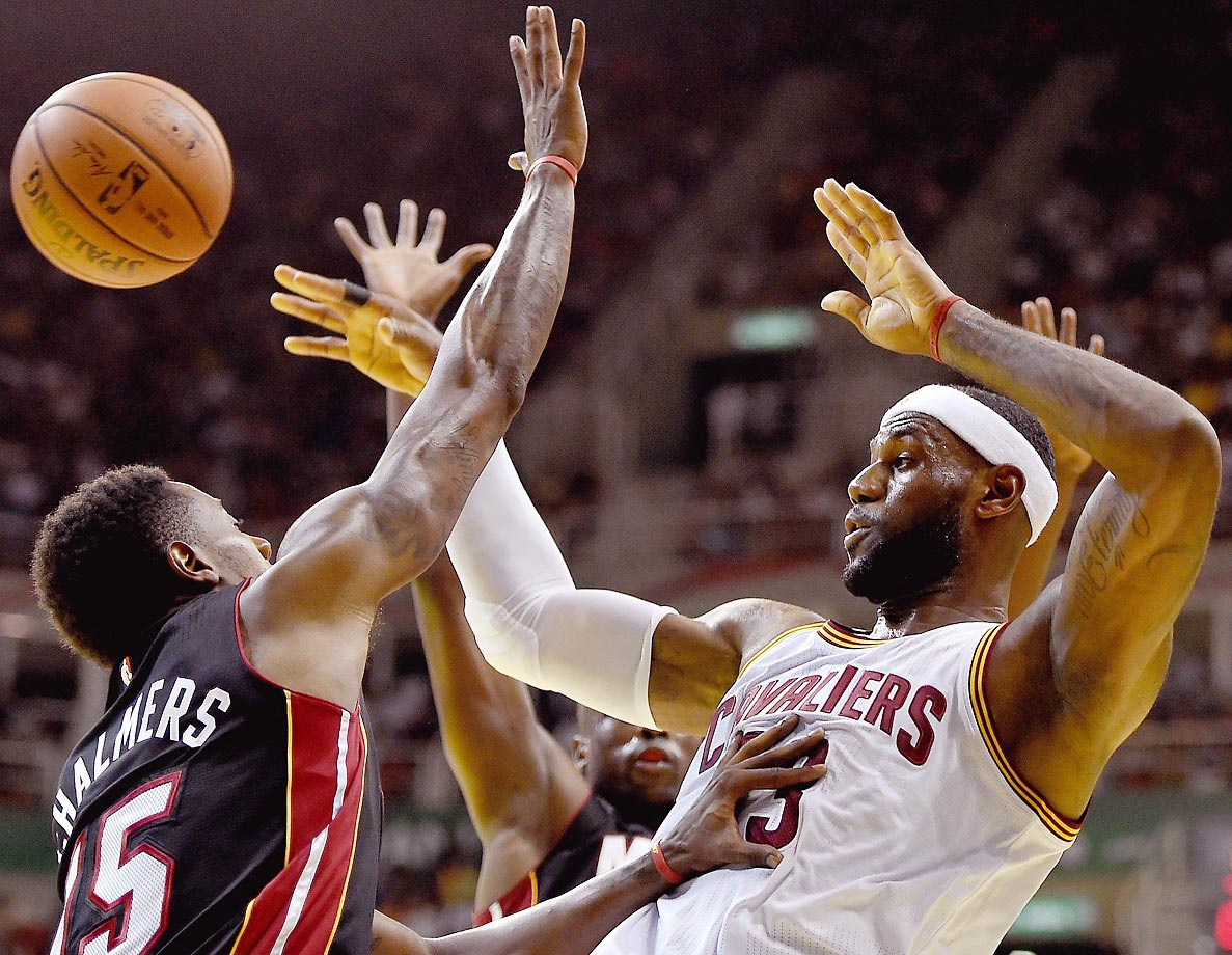 LeBron James of the Cleveland Cavaliers shoots against Mario Chalmers of the Miami Heat in an exhibition game in Rio de Janeiro, Brazil.