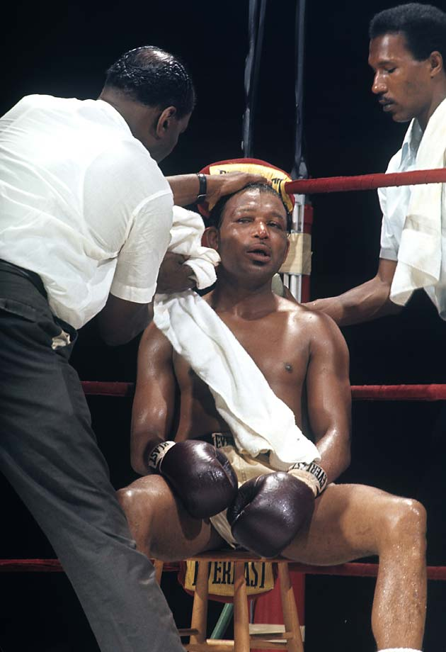 Sugar Ray Robinson sits in the corner during his fight with Stan Harrington at International Center Arena in Honolulu.