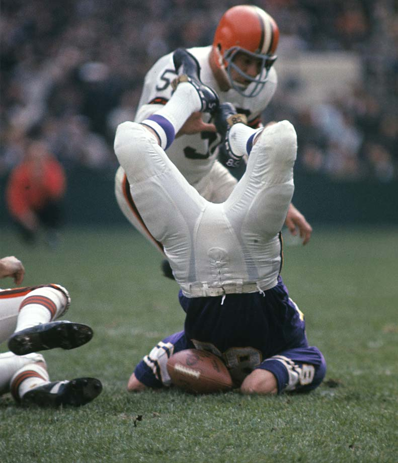 Paul Flatley of the Minnesota Vikings makes an awkward landing after being tackled during a game against the Cleveland Browns.