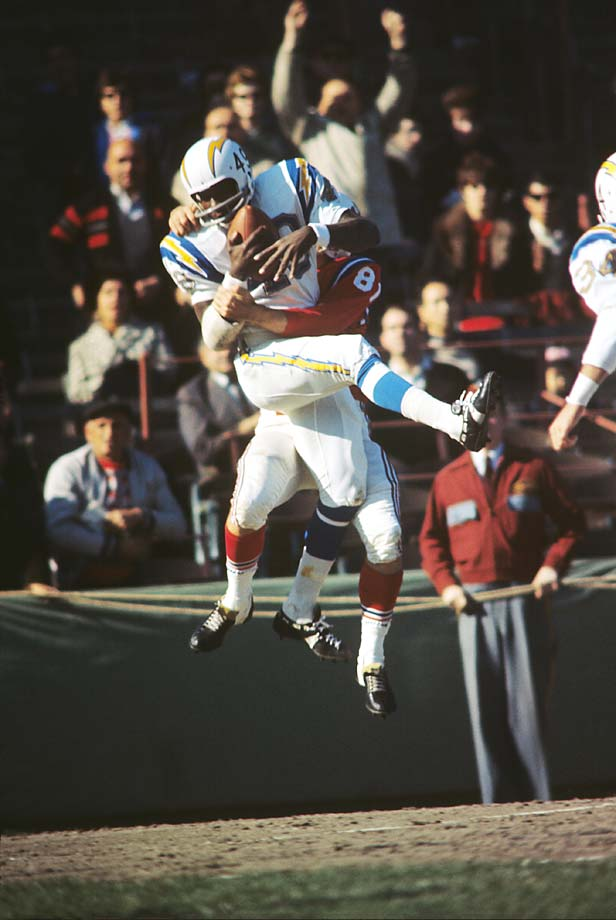 San Diego Chargers defender Jimmy Warren intercepts a pass intended for the Boston Patriots at Fenway Park.