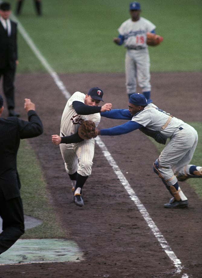Minnesota Twins' Harmon Killebrew is tagged out by Los Angeles Dodgers catcher John Roseboro.