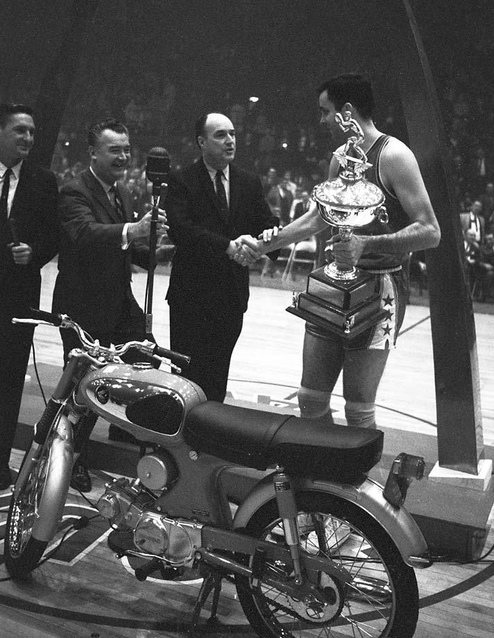 Team East's Jerry Lucas, the MVP of the All-Star Game, receives his trophy and motorcycle after his team beat Team West.