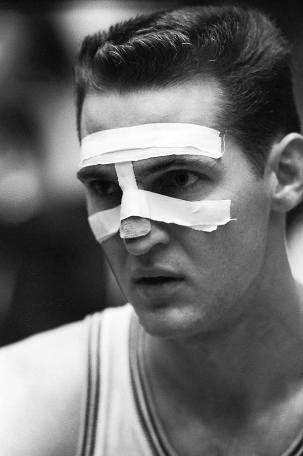 Jerry West of the Los Angeles Lakers had his face taped for this January game against the Cincinnati Royals because of a broken nose.