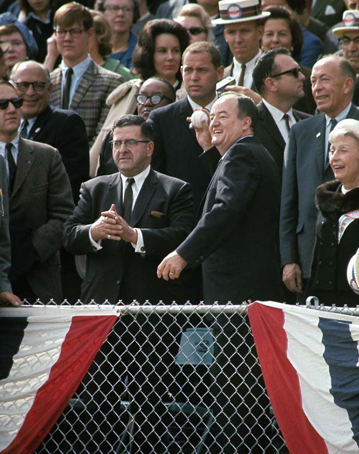 United States Vice President Hubert H. Humphrey throws out the ceremonial first pitch before Game 1 between the Minnesota Twins and Los Angeles Dodgers at Metropolitan Stadium.