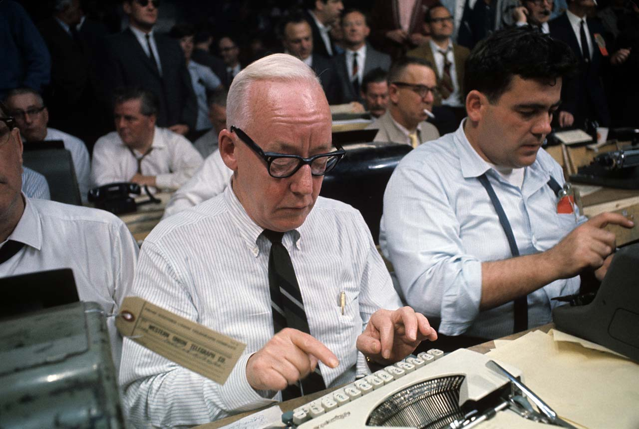 New York Herald Tribune columnist Red Smith types up his story during the Muhammad Ali vs. Sonny Liston fight.
