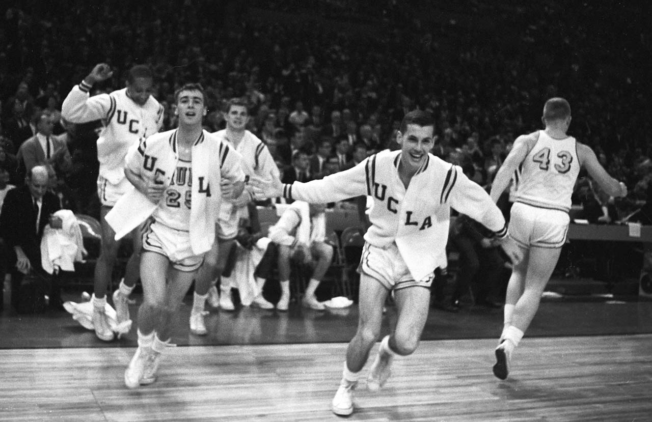 Gail Goodrich runs onto the court after winning the national championship vs Michigan at Memorial Coliseum.