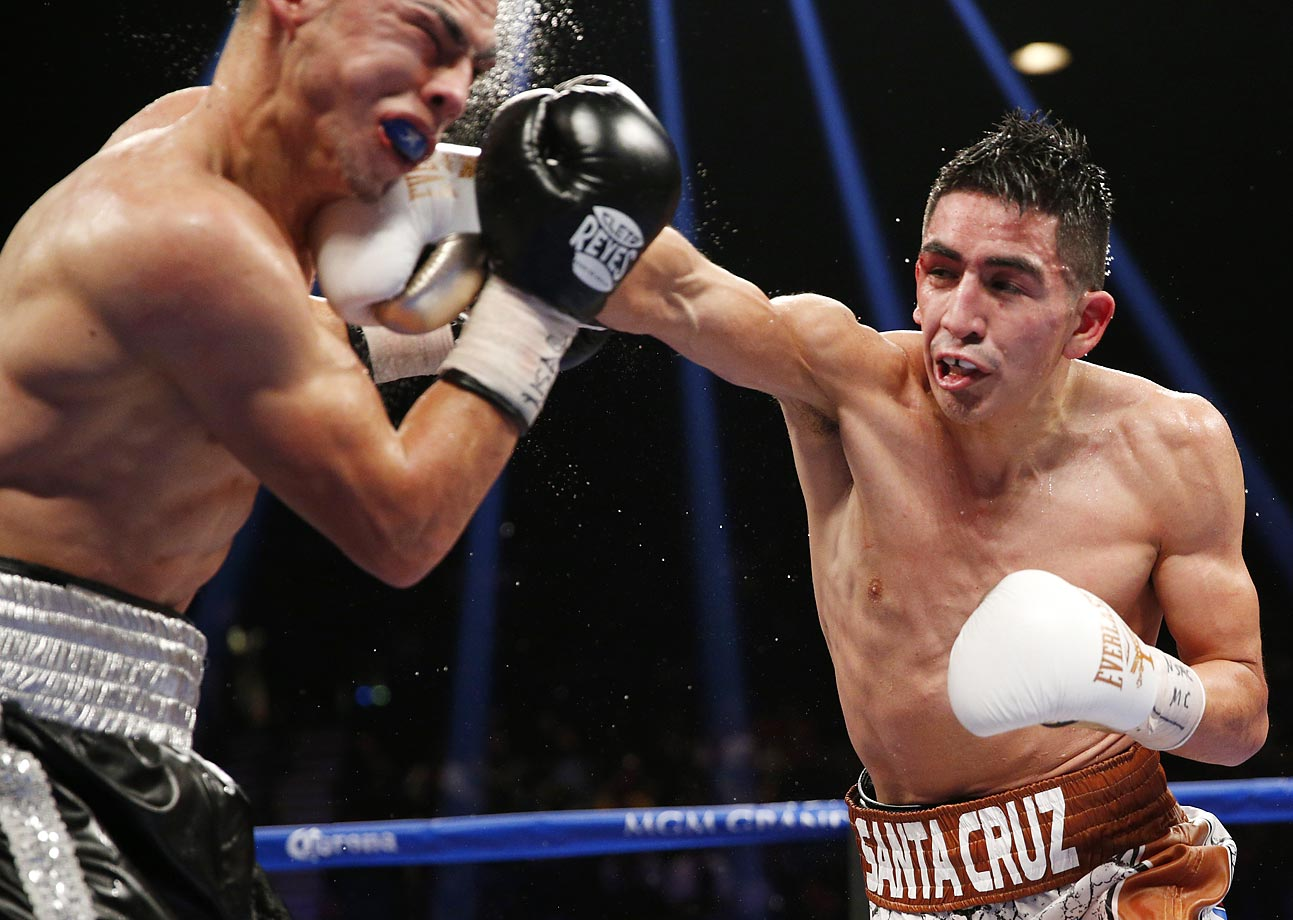 Leo Santa Cruz hits Jesus Ruiz during their WBC super bantamweight title bout  Jan. 17 in Las Vegas.