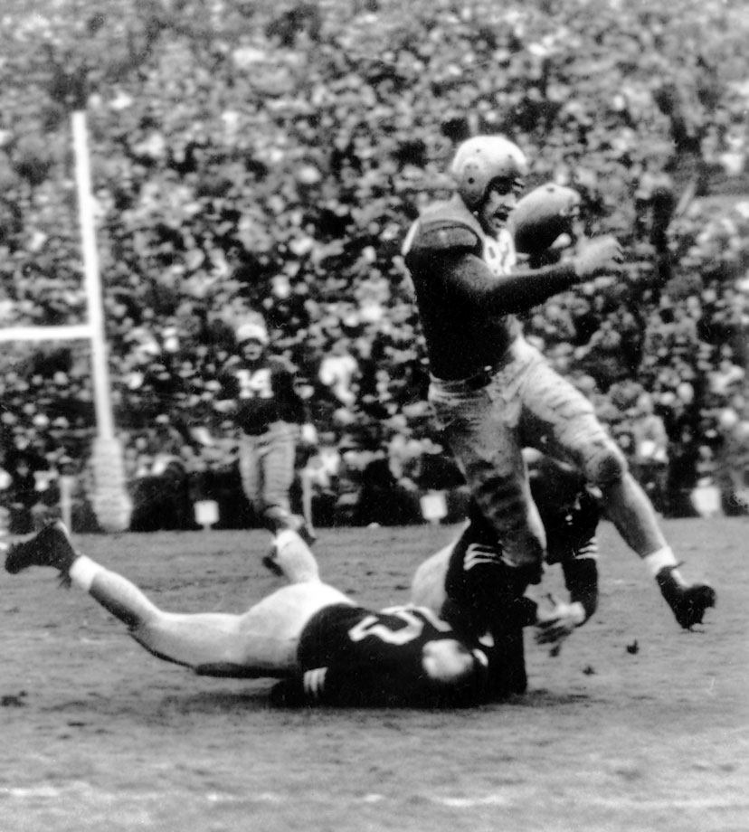 In four years on the field for the Fighting Irish, Hart never experienced defeat. The three-time All-American's Notre Dame teams went 36-0-2 thanks in large part to his defensive line play and pass catching. Hart is one of two defensive linemen to win the Heisman Trophy, running away with the race in 1949 to win the vote by 723 votes. In addition to his dominance at defensive end, Hart caught 19 passes for 257 yards and five touchdowns that season.