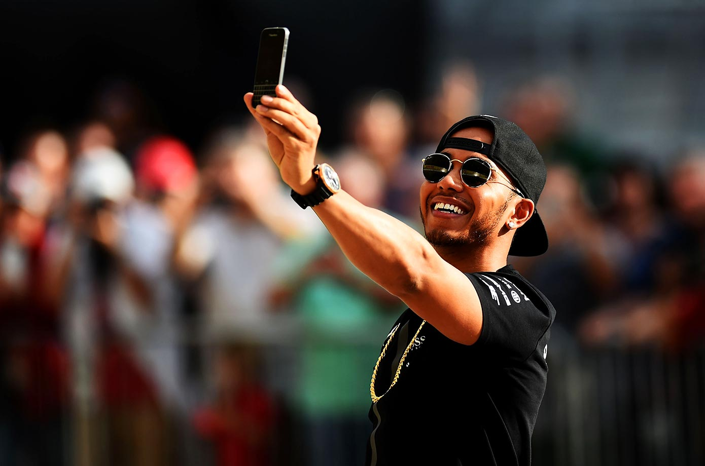 Lewis Hamilton takes a selfie in pit lane during previews for the U.S. Formula One Grand Prix in Texas.