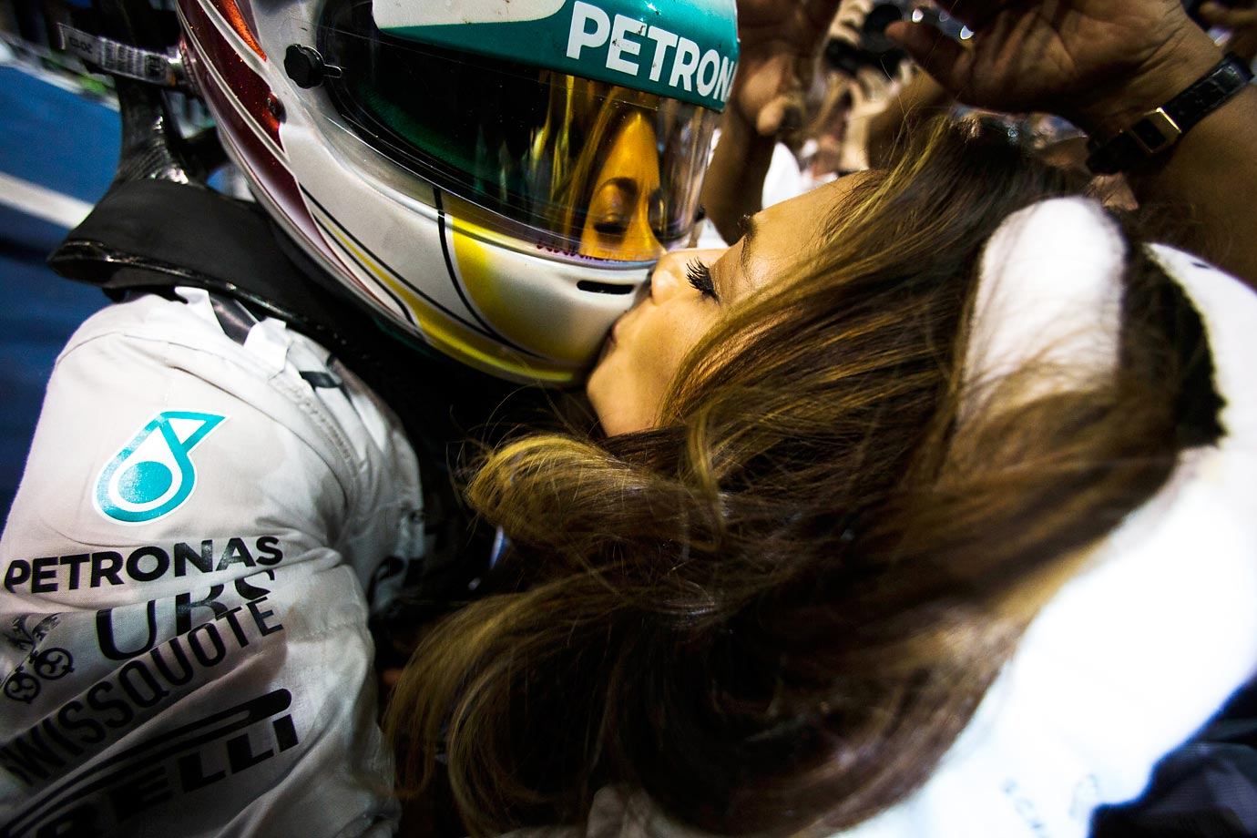 Lewis Hamilton's helmet receives a smooch from his girlfriend, Nicole Scherzinger, after he won the Formula One World Championship in Abu Dhabi.