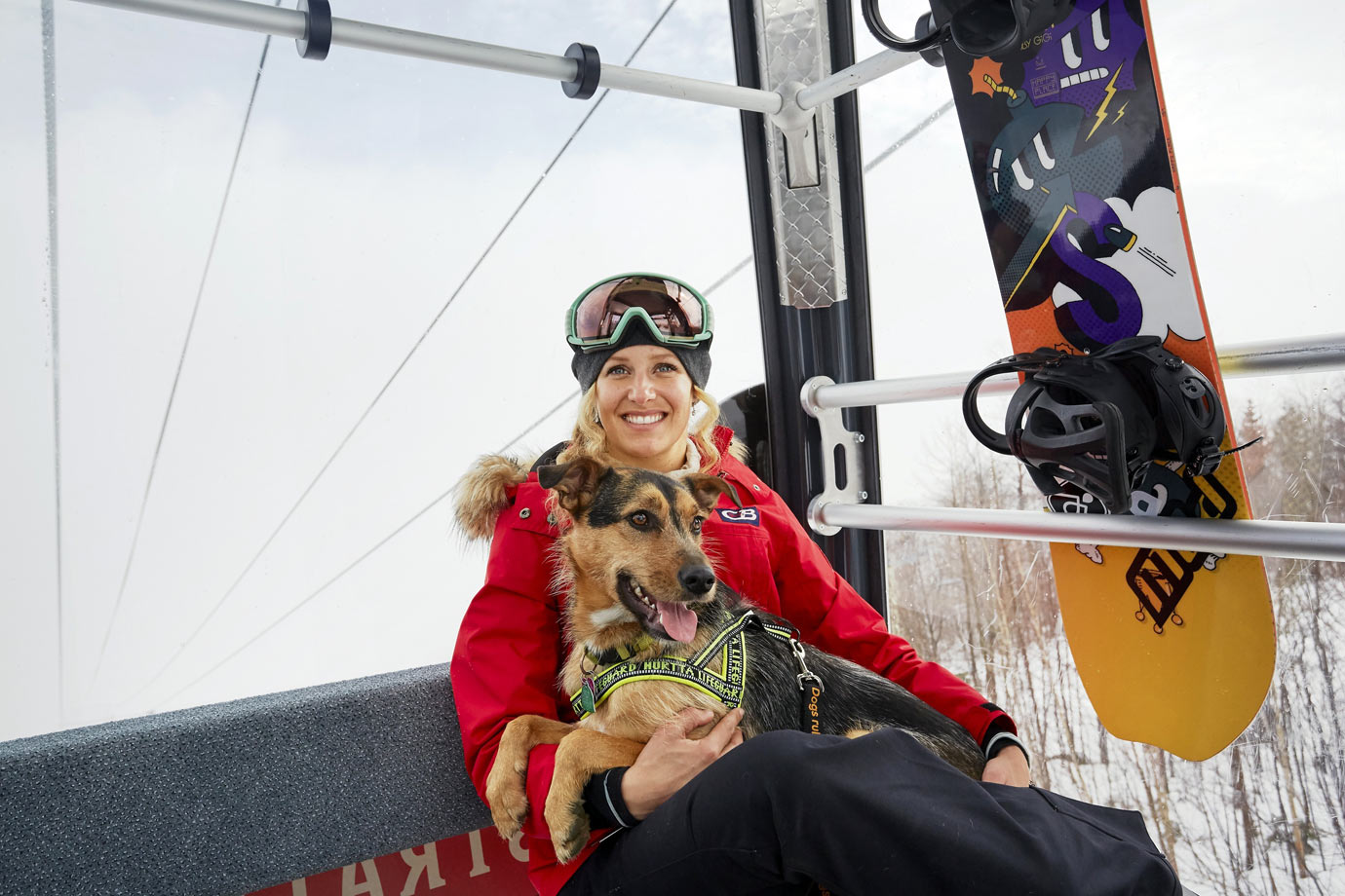 "Olympic snowboarder Lindsey Jacobellis's first encounter with the mutt came when he hitched a ride atop her equipment bag as she was wheeling it into the hotel lobby. ""I started bringing him treats,"" she says. Within a few days she had U.S. Snowboarding chefs preparing bowls of table scraps for him. Not long after, she began looking into how to bring the puppy, whom she would name for the Olympics' host city, back to Vermont."