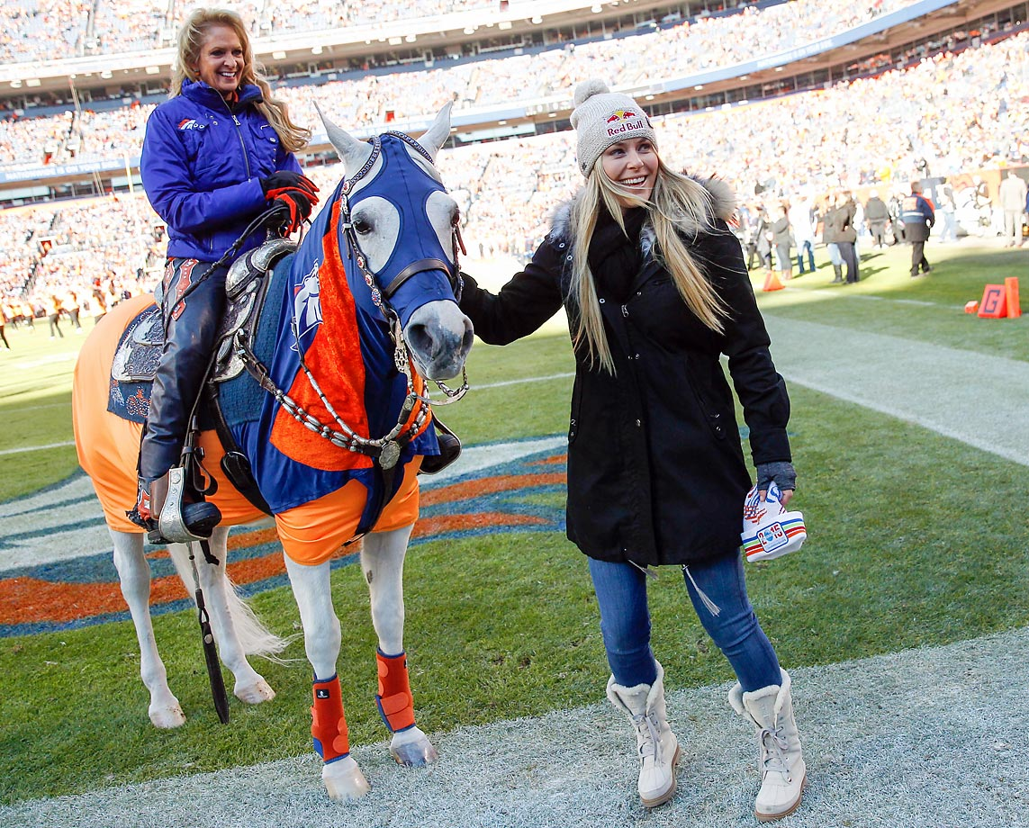 "Lindsey Vonn with Denver Broncos mascot ""Thunder"" before a game against the Raiders in December 2014."
