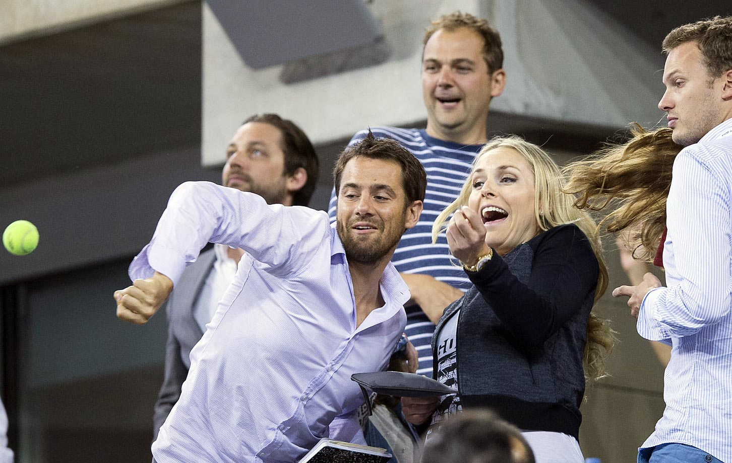 Lindsey Vonn fights for a ball hit into the crowd by Roger Federer after he defeated Gael Monfils during the ATP World Tour in September 2014.