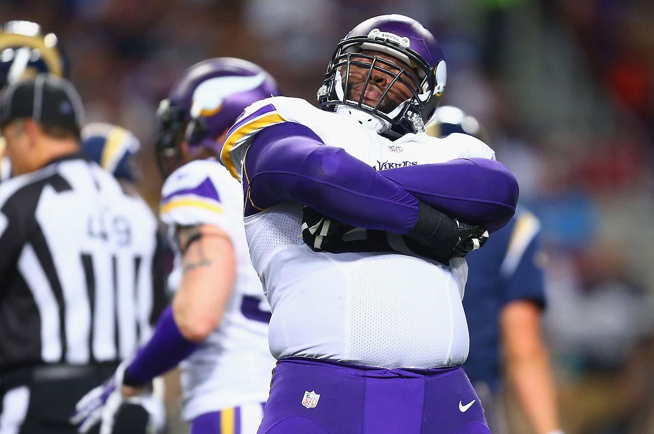 Linval Joseph of the Minnesota Vikings celebrates after sacking Austin Davis of the St. Louis Rams.