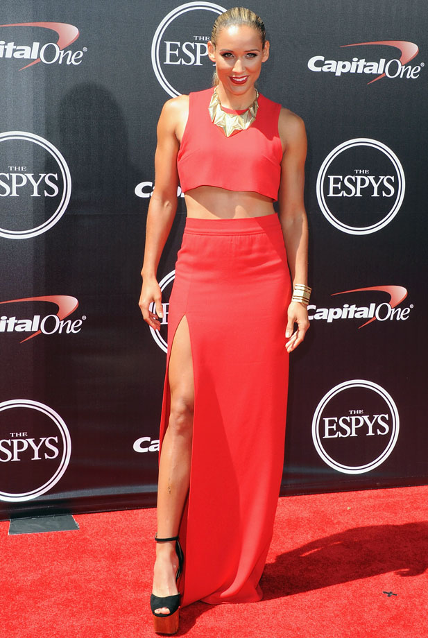 This has been a big year for the crop top. Lolo Jones balances out her exposed midriff with a long skirt for a fun, elegant look.