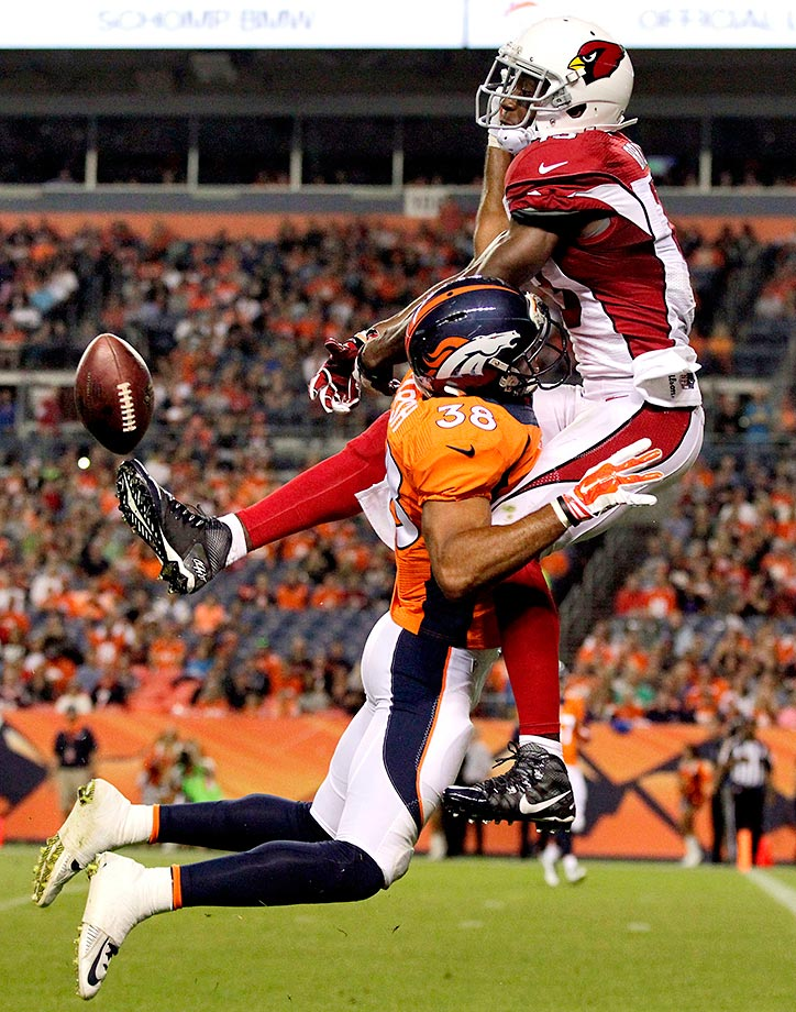 Denver cornerback Lorenzo Doss breaks up a pass intended for Jaron Brown.