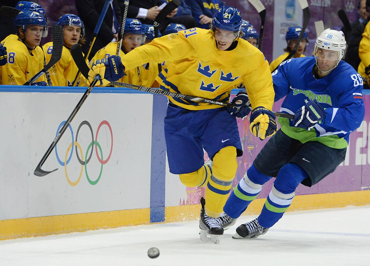 Swedish forward Loui Eriksson races after the puck as Slovenian defender Sabahudin Kovacevic attempts to disrupt the play.