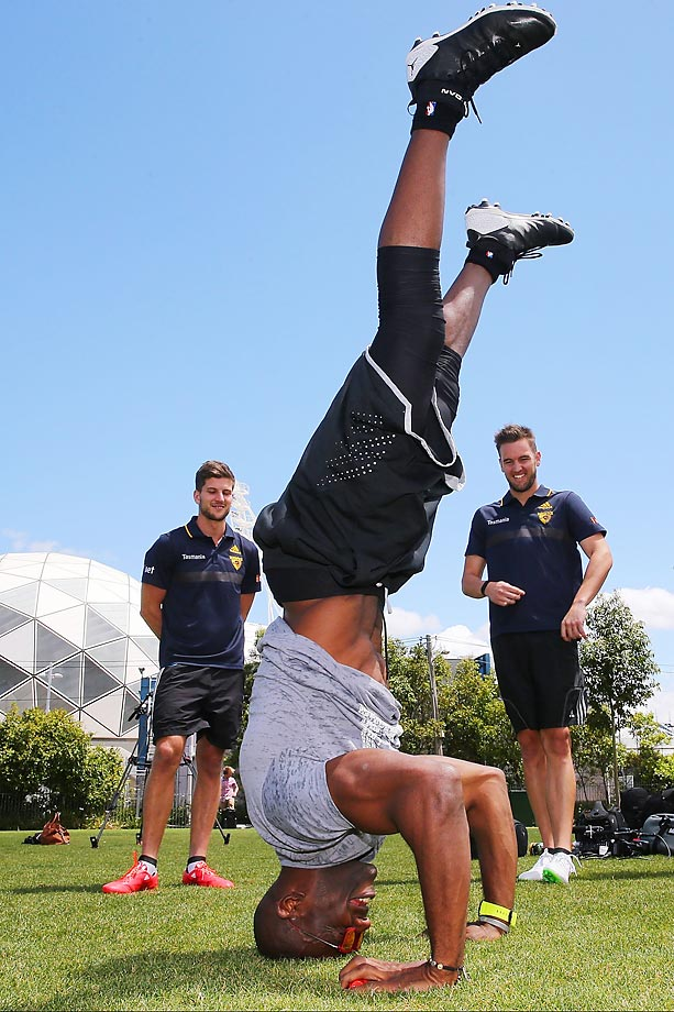 Terrell Owens does yoga at the Hawthorn Hawks AFL media event at Gosch's Paddock in Australia.  The Hawks hosted the former NFL star, , who was in town for the Ultimate Aussie Super Bowl Party.